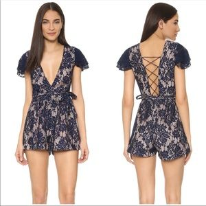 The JetSet Diaries Lace Floral Lace Up Romper Blue